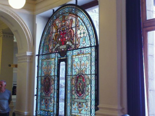 Stained glass from Queen Victoria's Diamond Jubilee, put in storage, forgotten for 62 years, discovered, brought out and hung here.