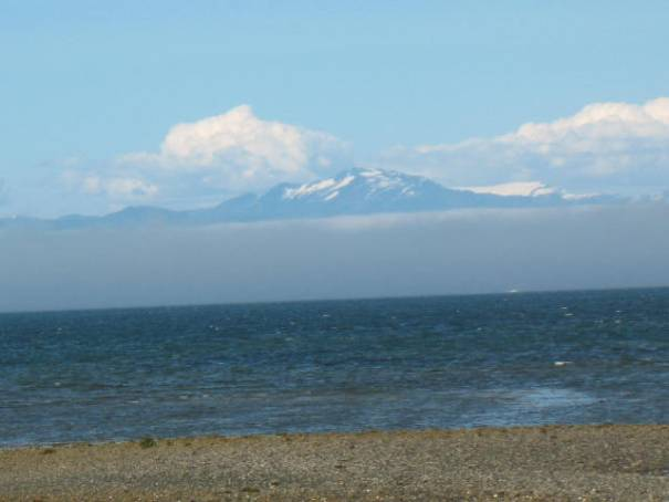 My favorite of the day: sand, sea, fog, mountain, snow, cloud and blue sky.