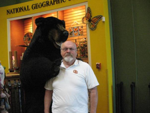 Grumpy old man forced by wife to pose with giant toy bear. (I really thought I was smiling).