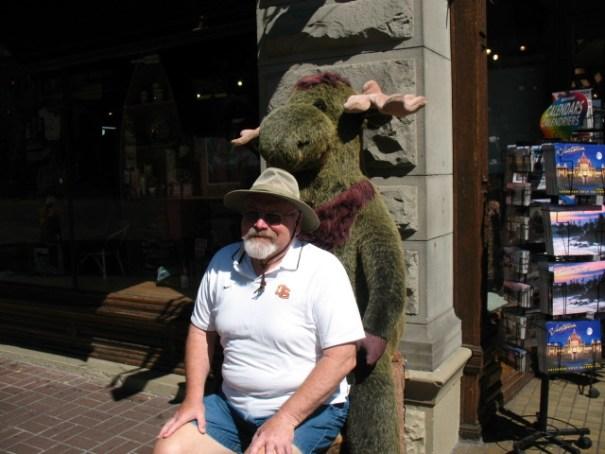 Grumpy old man gettin' tired of posing with stuffed animals.
