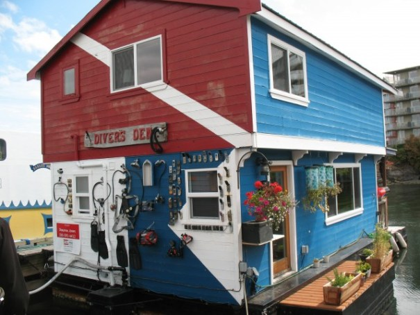 Divers Den is a fellow that dives and attaches what he finds in the water to the side of his Float House.  Cell phones, cameras, fins...
