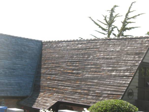 See this type of roofing in Carmel frequently.  We think it is Norwegian in origin.