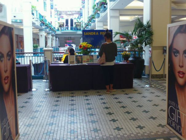 OMG a palm reader in the mall.  With customers!