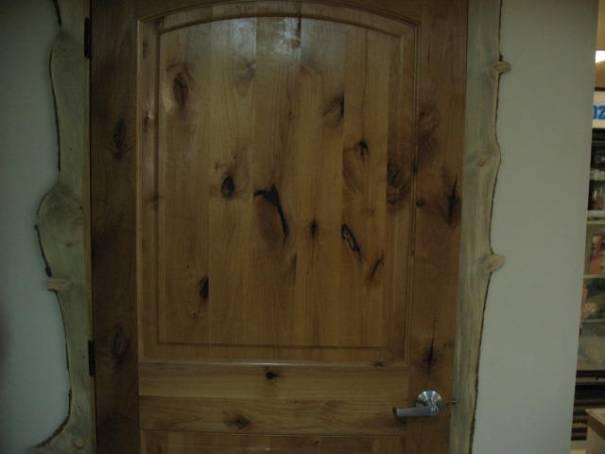 Knotty pine door with neat trim.
