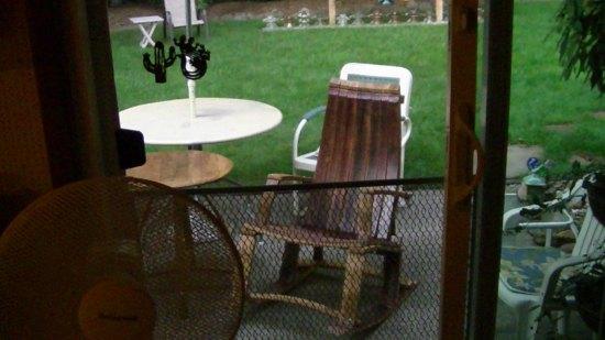 Oak wine barrel rocking chair.