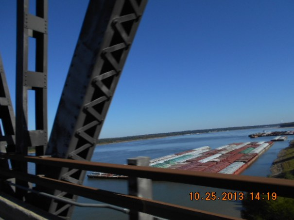 Barges on the Mississippi, as far as the eye can see both up and down and on both sides of the river.  Huge amounts of goods being moved.