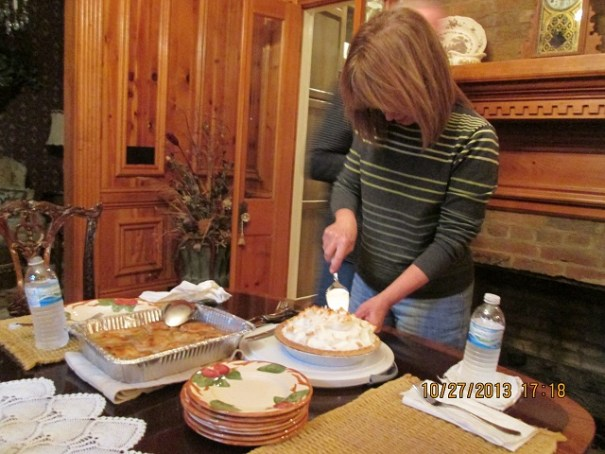 Cousin Kathy cutting and serving the wonderful chocolate meringue pie.