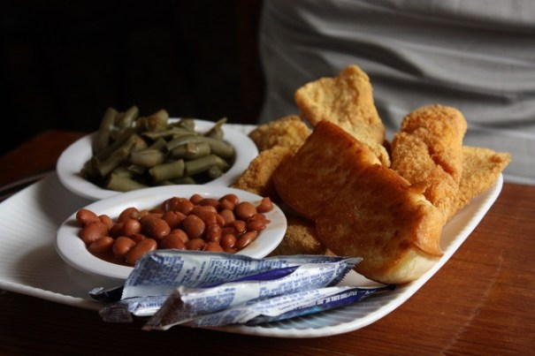 Catfish, green beans and pinto beans, with a roll.