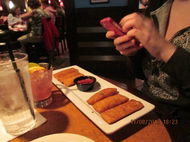 Lex's mozzarella cheese sticks with marinara sauce.