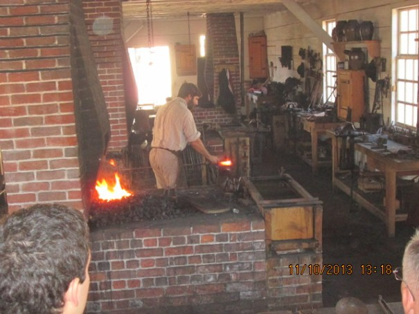 Blacksmith at work on a piece of iron.