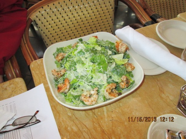 Because Celsa' time was limited Dan ordered her a Cesar salad with grilled shrimp.