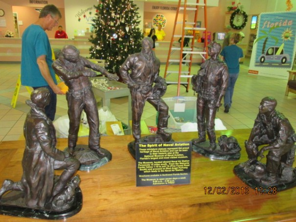 Statues honoring aviation heroes at the Welcome Center.