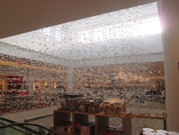 Great decorations on the second floor of Neiman Marcus.  White lace butterflies with little round mirrors all gently swaying in the wind,
