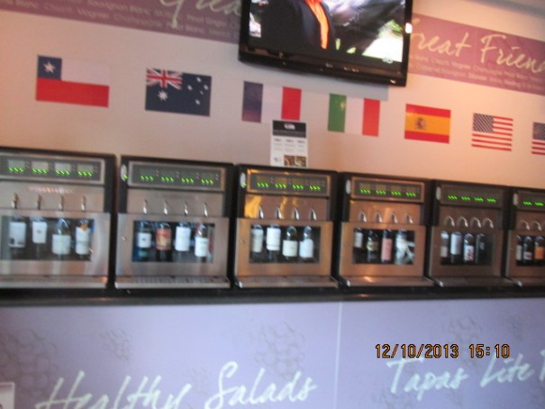 These are the wine dispensers, kind of like a gas pump.  The flags overhead signify the country of origin.