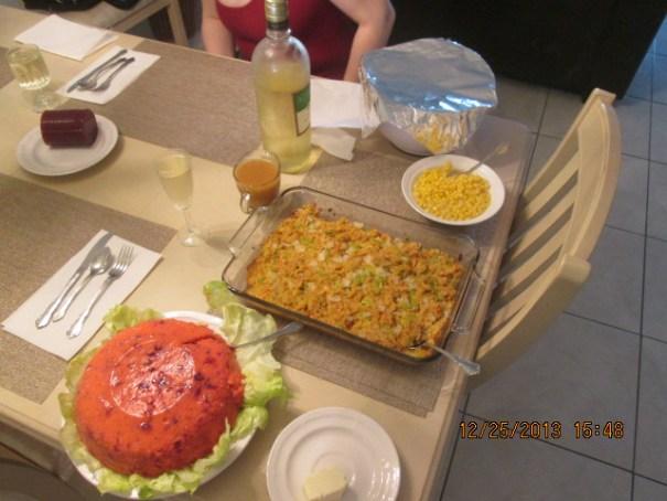 Mashed potatoes under the foil, Muscoto wine, corn, gravy, cornbread stuffing, cranberry sauce, purple jello and butter.