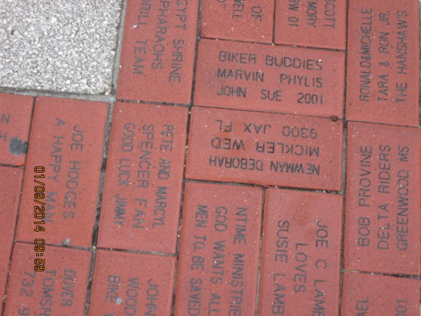The sidewalks have sponsored bricks.