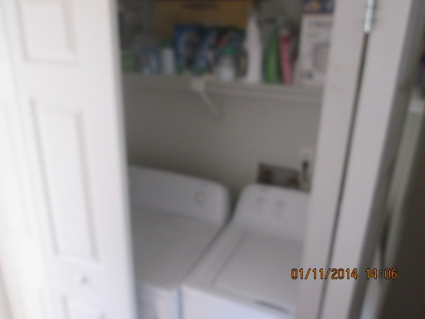 Full sized washer and dryer in the unit.