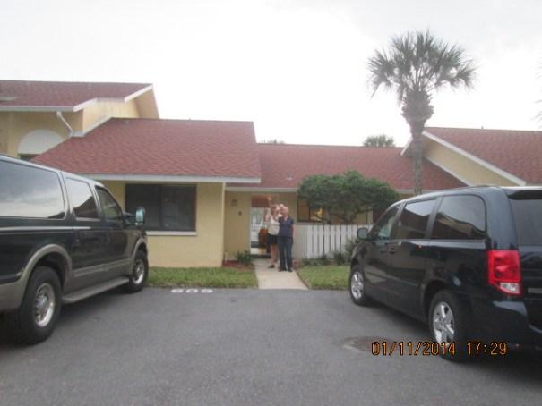 Ron, Joan and neighbor Nancy waiving goodbye.