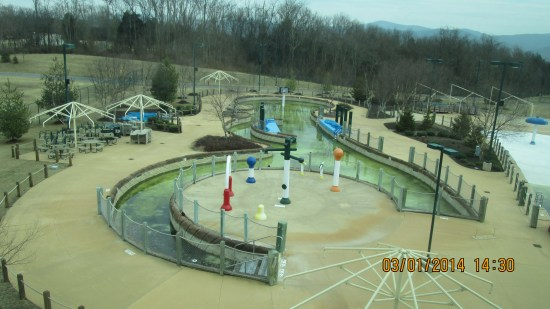 Outdoor lazy river closed for the season, gone green.