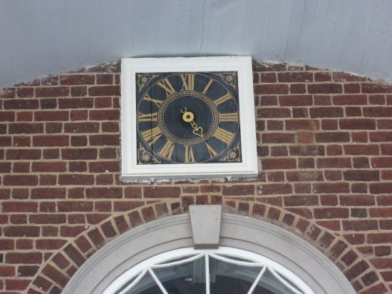 One handed outside face of two faced 7 day clock.  Inside face has 3 hands.