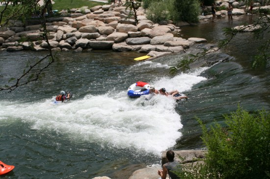 The rafters and kayakers really enjoyed the rapids.