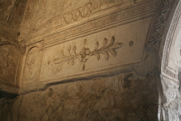 Frescoes on most walls.