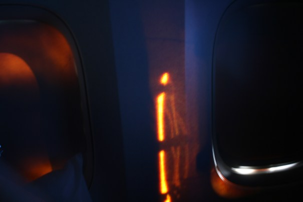 We are at 38,000 feet doing better than 600 miles per hour.  Stopped the steward and asked if this was normal.  He said the plane is okay, the sun is streaming in through the glass of the window.  The skin on the outside of the plane is intact.  He said the insulation has settled over the years, letting the light shine through.