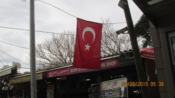 Shops, at the end of the Ephesus tour, flying the Turkish flag.