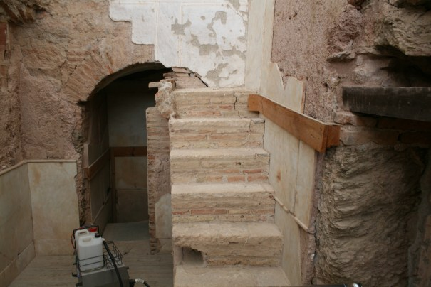 Original  stairs to a second floor.