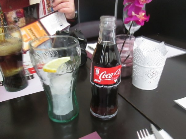 Stylish coke bottles and glasses.