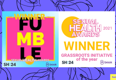 Fumble's logo and award win logo together on a purple background with a line drawing clitoris design pattern.