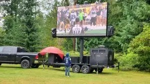 Football on LED screen in the day