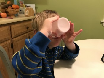 Drinking from an open cup is a challenge for many kids with special needs. Here's how we are learning this life long skill.