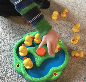 Play a simple game and enjoy some time with your child while working on therapy homework for fine motor skill development.