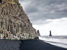 Reynisdrangar are located close to the town of Vík in ...