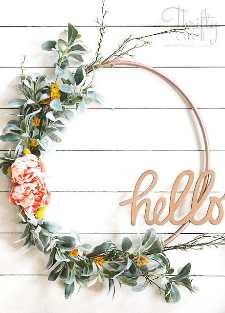 I never would have guessed that this is a hula hoop wreath. There are so many amazing spring wreath ideas in this post, but I think this might be my favorite. (from Thrifty and Chic)