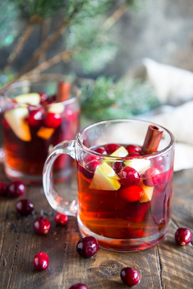 This cranberry apple cider is easily made in a crock pot and will make your home smell so good! Make it this Fall and share with friends!