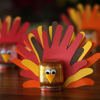 Get the kids to help with Thanksgiving table decorations with these handprint turkey crafts.