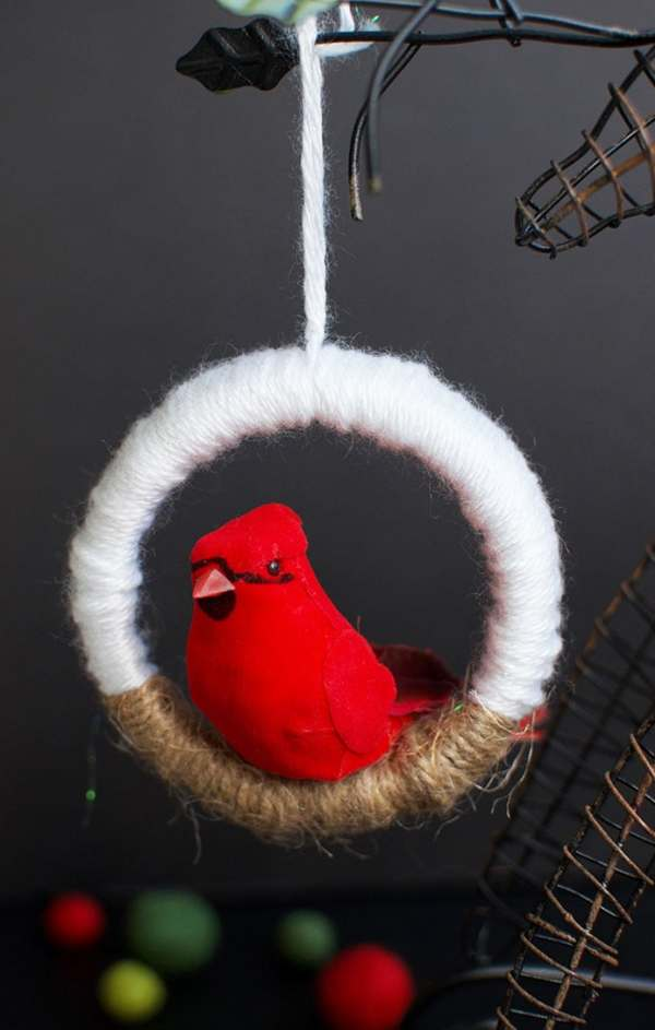 Make this charming and easy DIY Christmas ornament in no time flat using mason jar lids and yarn. You won't believe where I found this perfect bird for the ornaments. Click over to see how to make your own. #DIYChristmas #BirdOrnament #MasonJarLidOrnament
