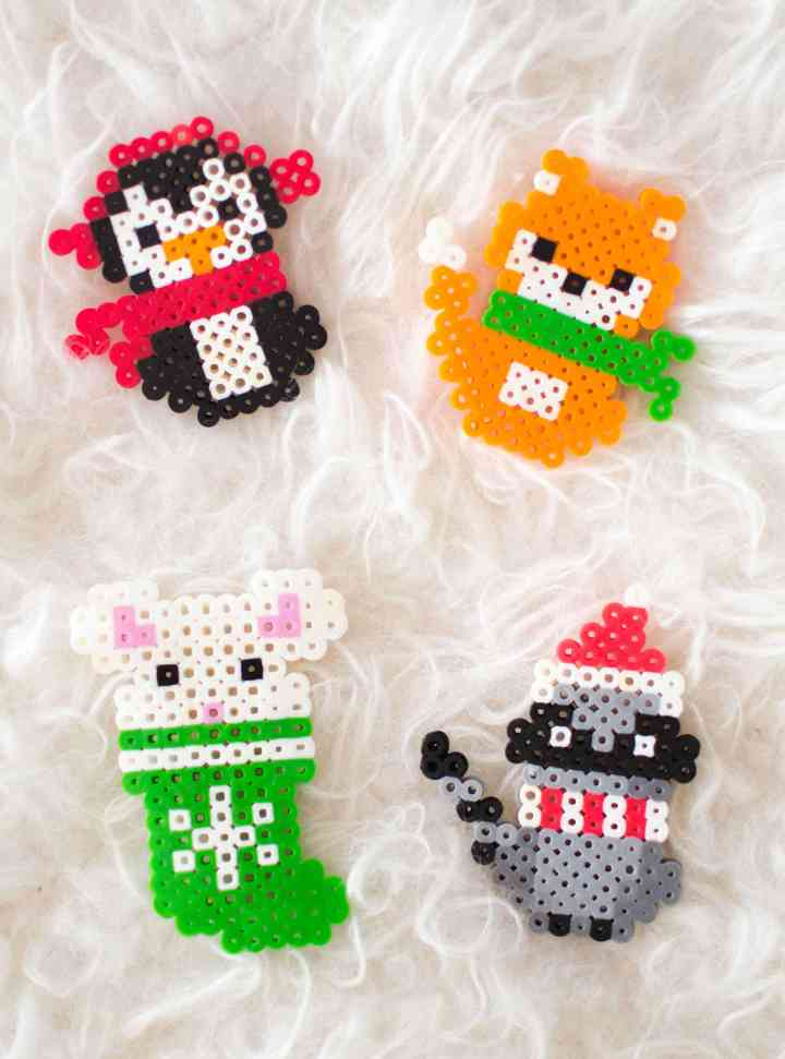 Make these adorable Christmas melty bead ornaments with our printable patterns. #KidsCraftIdeas #DIYChristmasOrnaments #PerlerBeadChristmasPatterns #