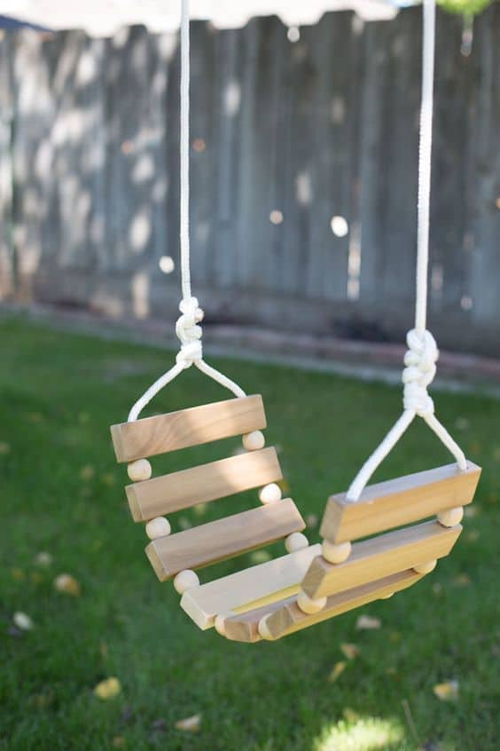 Genius ideas for kids backyard play spaces, incuding this wooden swing tutorial for your kids outdoor play space (via Momtastic).