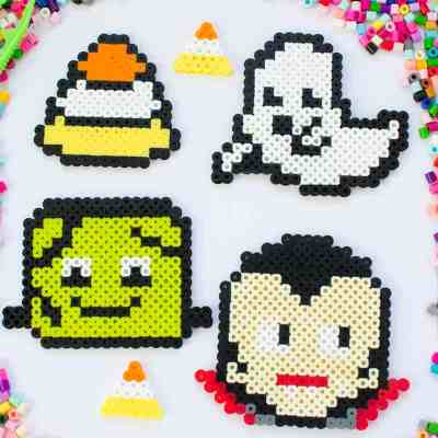 Perler bead designs for halloween. Lots of other perler bead patterns here, too. #perlerbeads #hamabeads #fusebeads #meltybeads #halloween #halloweenkidscrafts