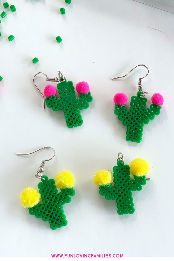 fuse bead earrings shaped like cacti with pom pom flowers