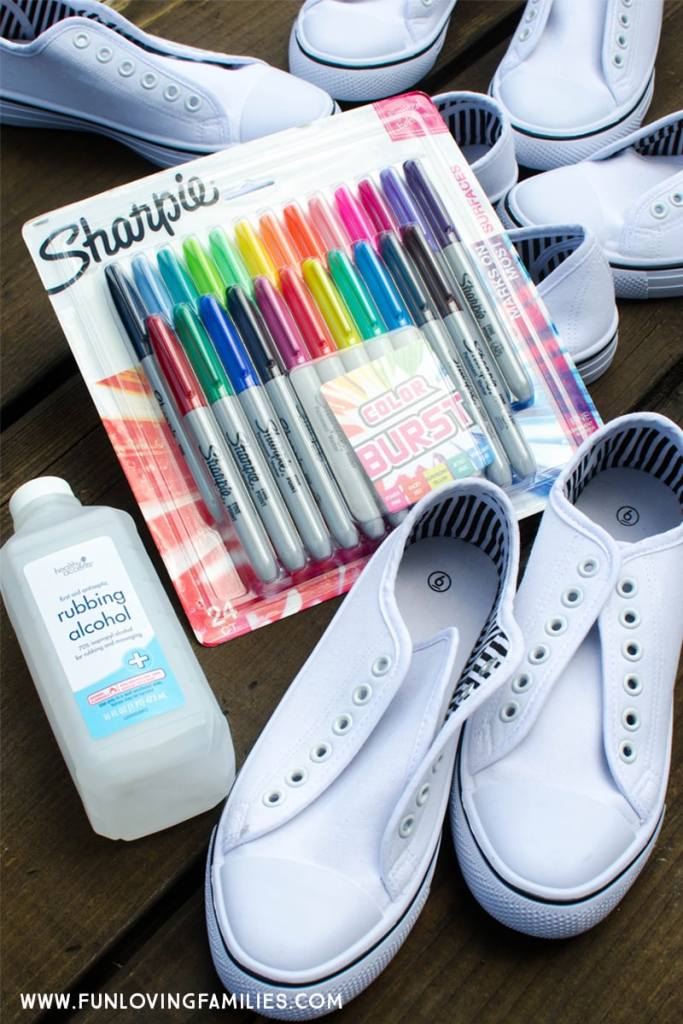 supplies for dying shoes with sharpie: white shoes, rubbing alcohol, sharpie markers