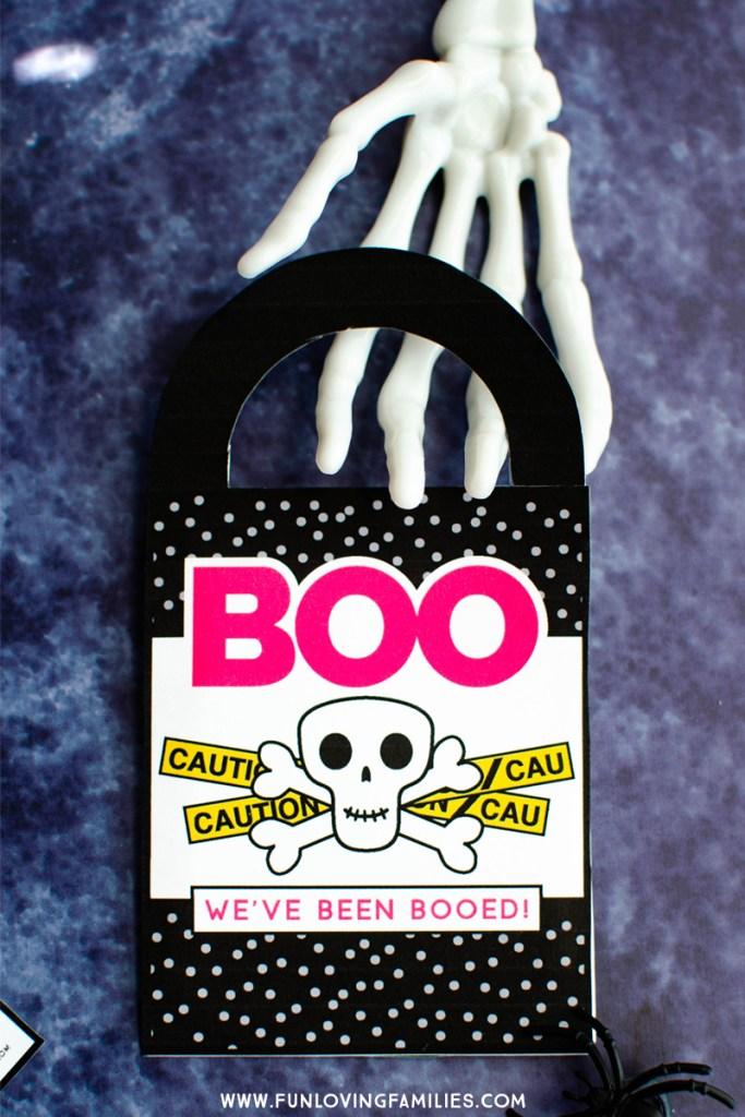 We've Been Booed door hanger free printable with cute skeleton.