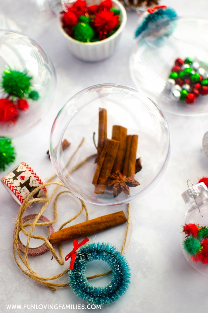 clear Christmas ornaments filled with colorful crafting supplies