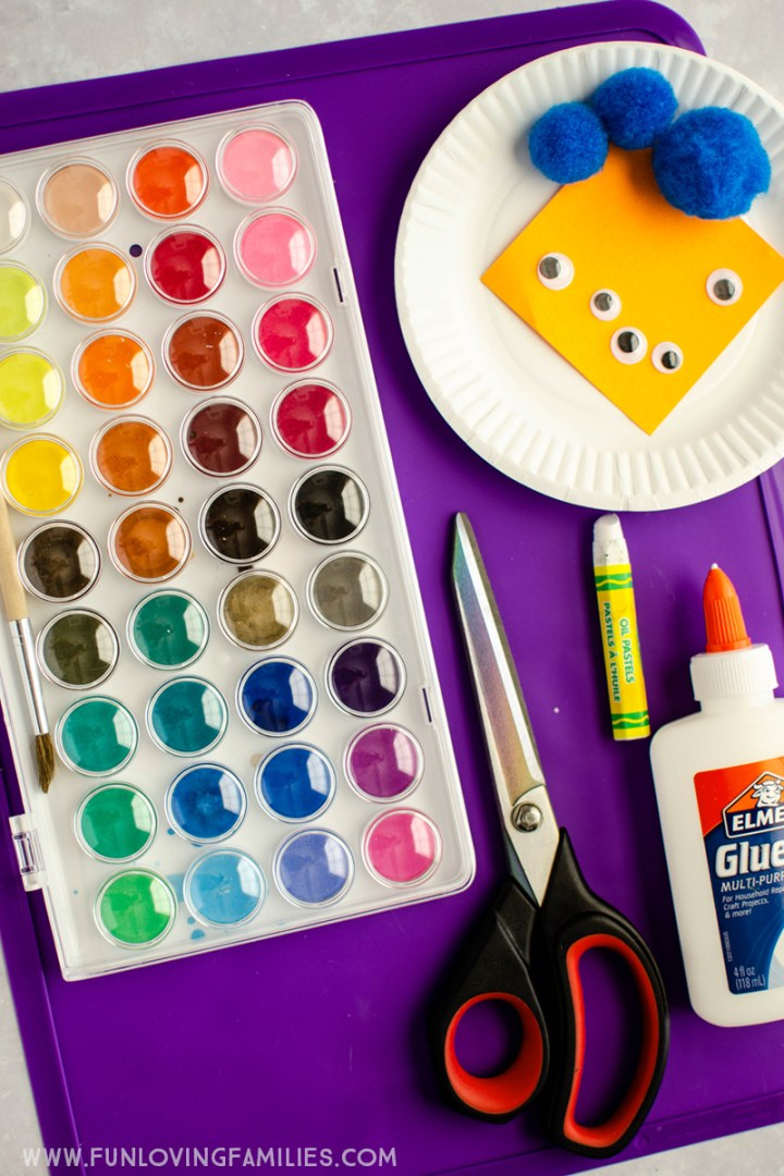 supplies for making paper plate bird nests and pom pom birds
