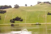 Soccer field painted on side of large, sloping hill