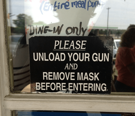 Please unload your gun and remove mask before entering
