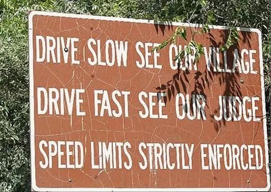 Drive slow, see our village. Drive fast, see our judge.
